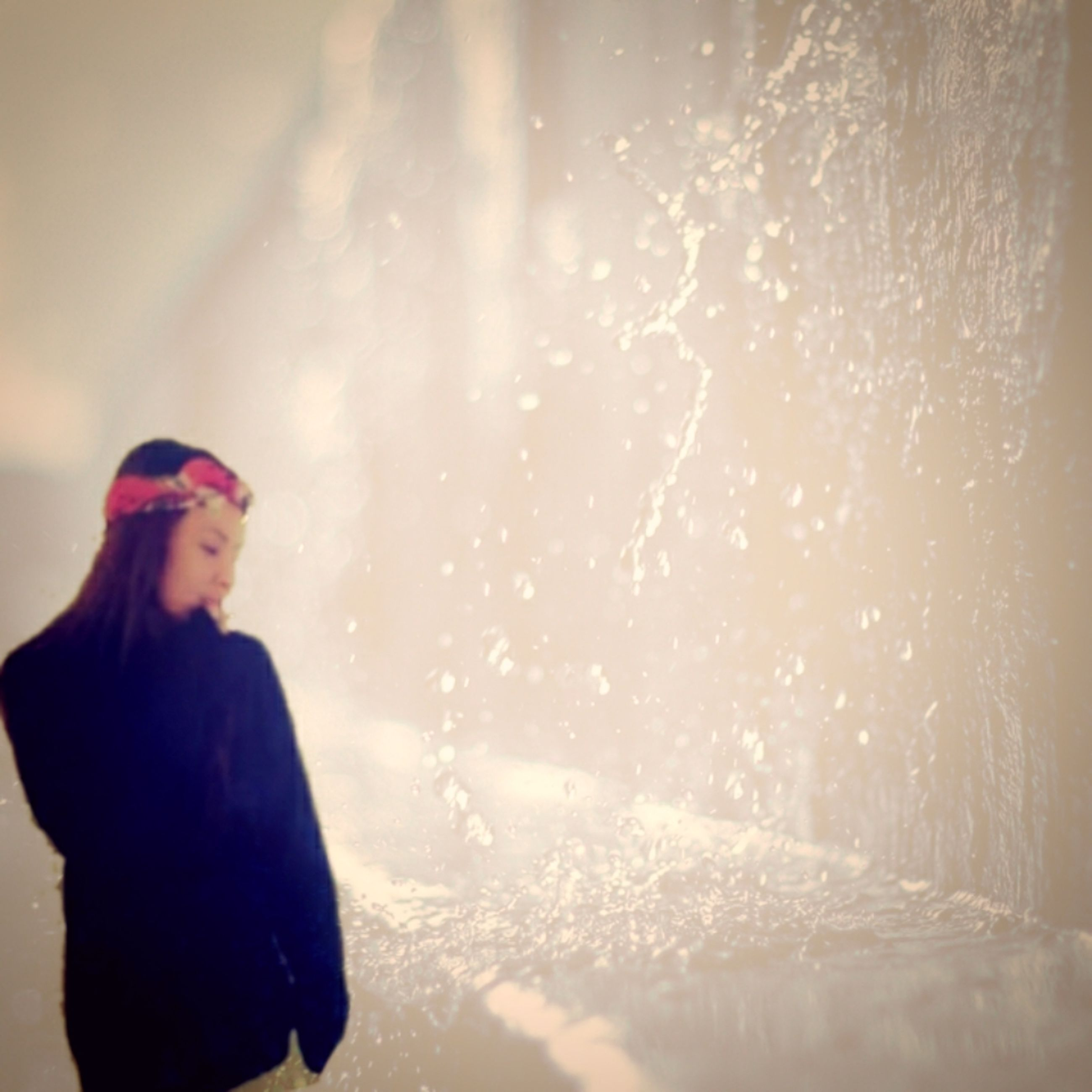 lifestyles, leisure activity, standing, young women, person, young adult, winter, rear view, long hair, season, cold temperature, headshot, casual clothing, three quarter length, water, snow, waist up, weather