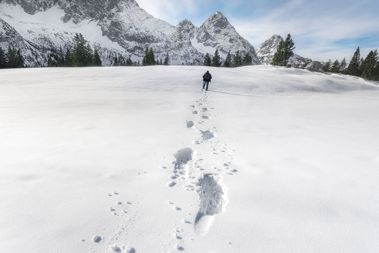 Person standing on snowcapped mountain