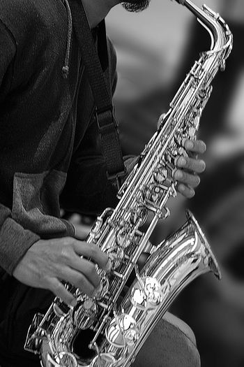 Music Serenade Artist Arts Culture And Entertainment Black And White Leisure Activity Music Musical Instrument Musician Performance Playing Saxophone Skill  Street Performer Street Photography Wind Instrument The Street Photographer - 2018 EyeEm Awards EyeEmNewHere
