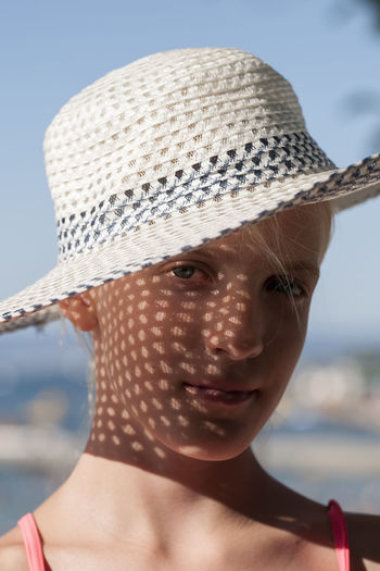Close-up portrait of woman wearing hat