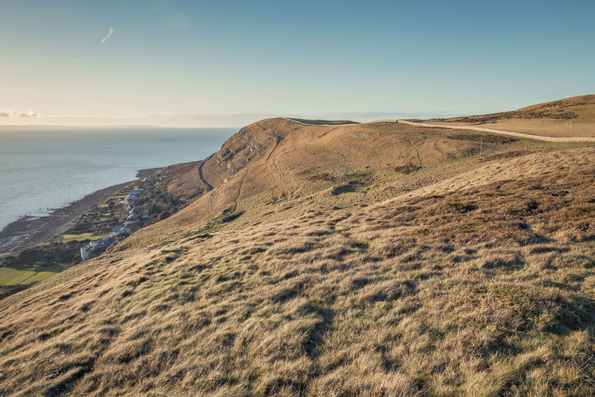 Headland on the North Coast of Wales Grass Slopes Travel Wales Beauty In Nature Cliff Cloudless Sky Coast Day Destination Great Orme Headland Hill Island Landscape Mountain Nature No People Outdoors Scenics Sea Sky Sunset Tranquil Scene Tranquility