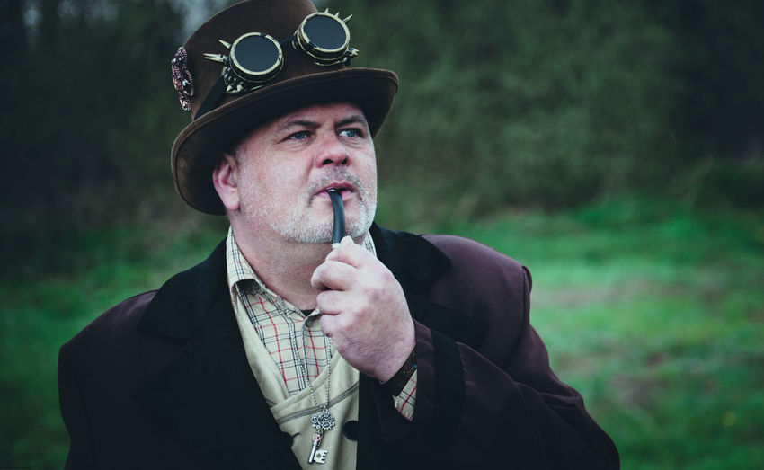Portrait of man in steampunk outfit  outdoors