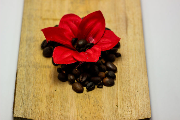 High angle view of red berries on table