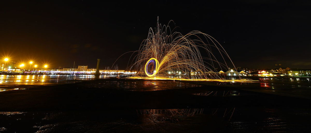Wire Wool spinning Motion Illuminated Long Exposure Night Wire Wool Nature Outdoors Water Reflection Architecture Sky Built Structure River Building Exterior Glowing No People City Arts Culture And Entertainment Waterfront Blurred Motion Firework Light