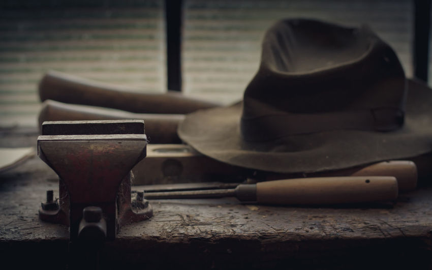 The old bench where he stood Abandoned House Bench Hat Old Bench Abandoned Abandoned_junkies Close-up Day Indoors  No People Nostalgia Nostalgic  Old Hat Old Tools Old-fashioned Olden Days Still Life Table Time Time To Reflect Tools