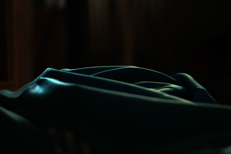 Close-up of silk textile in dark room