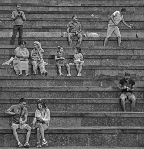 High angle view of people sitting on staircase