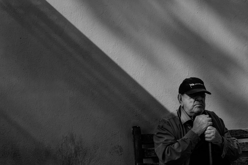 between the shadows and the lights Old-fashioned Streetphotography Street Street Street Photography Streetphoto_bw Contrast Bnw Blackandwhite Men Candid Army Headwear Street Scene White Line Retro Styled