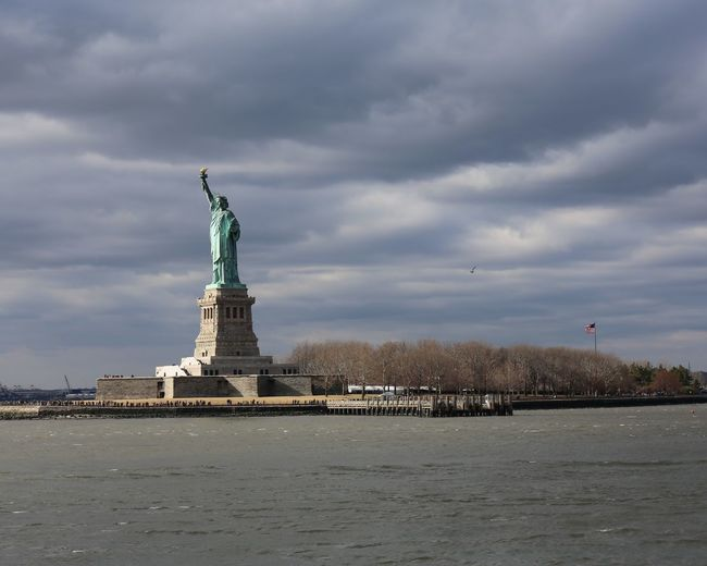 Statue of liberty against cloudy sky