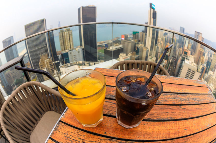Hong Kong, China - January 1, 2016: aerial view of city skyline and cocktail from the top of The Hennessy in Wan Chai, a modern skybar in the city. HongKong Hong Kong City Hong Kong Sunset Skyline Night Cityscape Business Aerial View Light Show Laser Show Skyscraper Victoria Harbor Panorama Building Exterior Architecture Built Structure No People City Food And Drink Close-up Container Table Household Equipment Building Refreshment Glass Still Life Sky Kitchen Utensil Focus On Foreground Nature Outdoors Food Office Building Exterior
