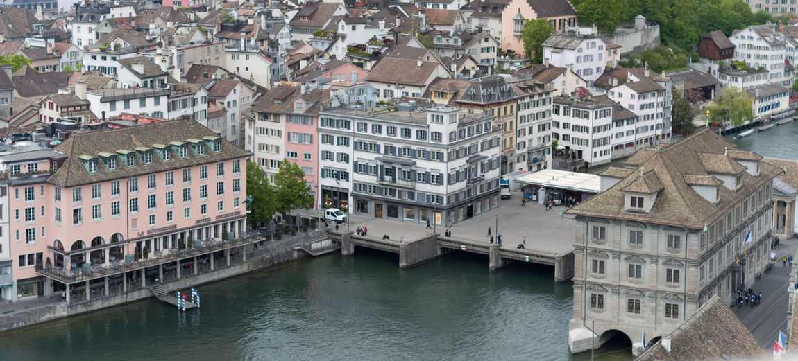 touristic hint: the pier with blue/white poles is a boat stop for the funny boats circulating as a part of the public transportation system. You can board them with an ordinary bus/tram ticket. Their route is upstream limmat into the Zürichsee, then to one of the two lakesides, then across the lake and back downstream Limmat right to the Landesmuseum next to the Main Station. The boats are a real fun to ride, lying very deep in the water, giving a great perspective for the viewers and the photographers.... you should not miss this ride if you ever stop by in Zürich 🤓🙋 Linsen über Zürich Urban High Angle View Limmat Tourist Destination Boat Stop Pier Public Transportation Bridge Gondola - Traditional Boat Water City Cityscape Cultures Waterfront Architecture Old Town Boat Aerial View Downtown River Town Square TOWNSCAPE