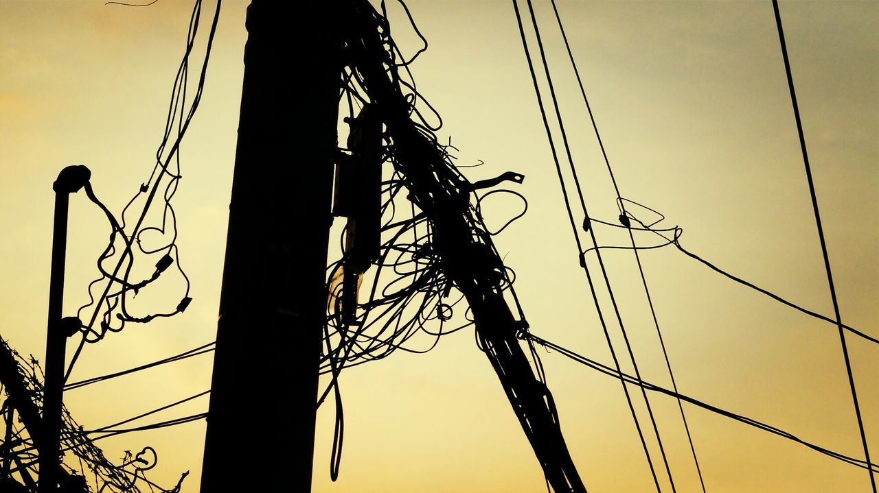 cable, connection, complexity, power line, electricity, power supply, technology, low angle view, fuel and power generation, tangled, silhouette, electricity pylon, no people, sky, outdoors, telephone line, day