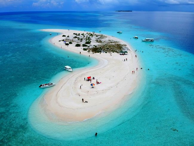 Aerial view of the beautiful white sandbank, surrounded by layers of blue water in Maldives Sandbank Maldives Blue Ocean Coral Reef Vacation Visit Tour Trip Crystal Deep Blue Water Layer Shallow Clouds White Peaceful Relax Island Inhabited Green View Ocean Excursion Beach Sea Turquoise Colored Water High Angle View Sand Aerial View Vacations Tranquility Idyllic Beauty In Nature Travel Destinations Tranquil Scene Scenics Nature Day Horizon Over Water Outdoors Blue Go Higher