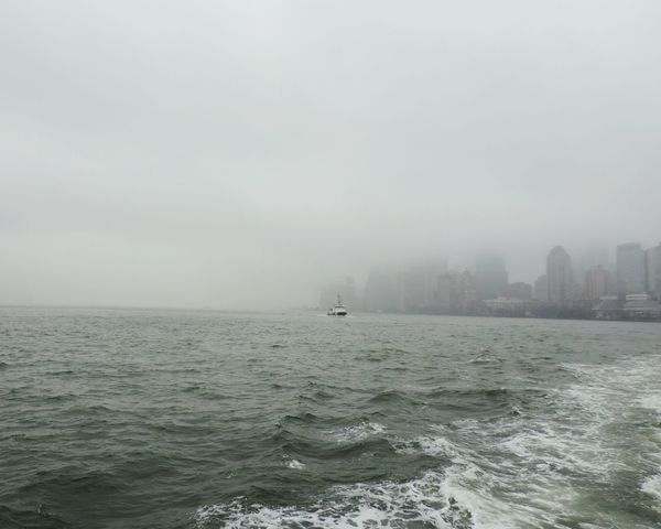 NY Newyork Ellis Island  Ferryboat USA Winter Rainy Day Fog