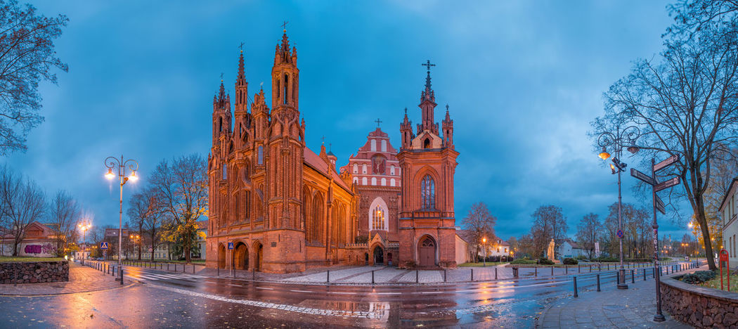 Church of St. Anne, Vilnius at Dawn captured in high resolution panorama. Blue Hour Cathedral Catholic Church Church Of St. Anne Exterior High Resolution Panorama Place Of Worship Rain Saint Anne St. Anne Church Twilight Blue Sky Building Exterior Church Architecture Clouds Clouds And Sky Dawn Day No People Tourism Travel Destinations Twilight Sky
