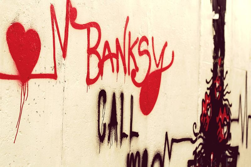 Banksy Banksy Style Banksy Art Banksyart Banksy Graffiti Text Communication Red Built Structure Architecture Art And Craft No People Western Script Creativity Building Exterior Wall Message Street Art Close-up Day Non-western Script Paint Messy