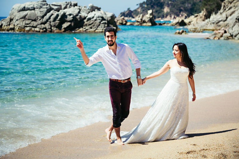 Adult Adults Only Beach Bride Bridegroom Couple - Relationship Females Full Length Heterosexual Couple Husband Love Males  Married Men Romance Sand Sea Standing Togetherness Two People Water's Edge Wedding Wedding Dress Wife Women