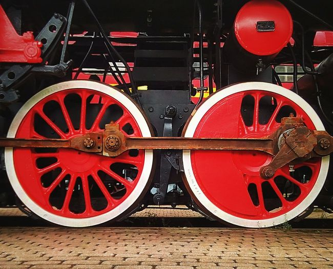 Red wheels of steam locomotive Red Outdoors Close-up Wheels Locomotive Old Locomotive Railway Red Wheels Steam Locomotive Engine Old Engine Rust Rails Train