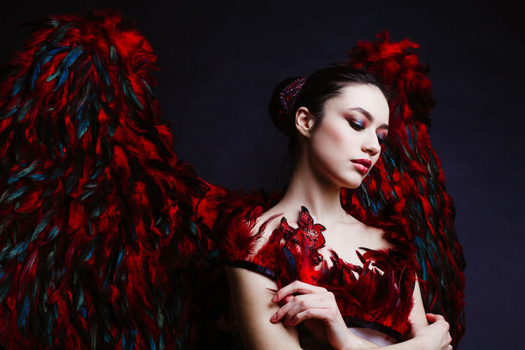 Beautiful Woman With Angel Wings Against Black Background