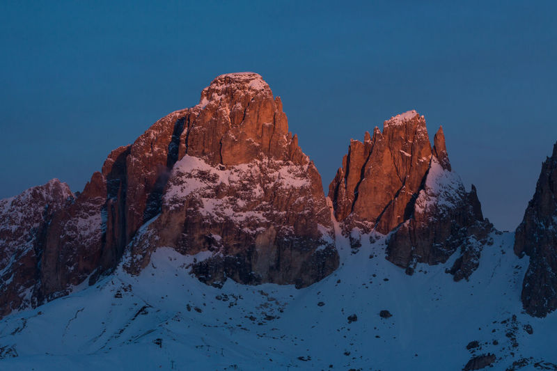 Langkofel Dolomites, Italy Langkofel Beauty In Nature Blue Clear Sky Cold Temperature Environment Extreme Weather Formation Italy Mountain Mountain Peak Nature No People Physical Geography Rock Rock Formation Scenics - Nature Sky Snow Snowcapped Mountain Solid Tranquil Scene Tranquility Winter