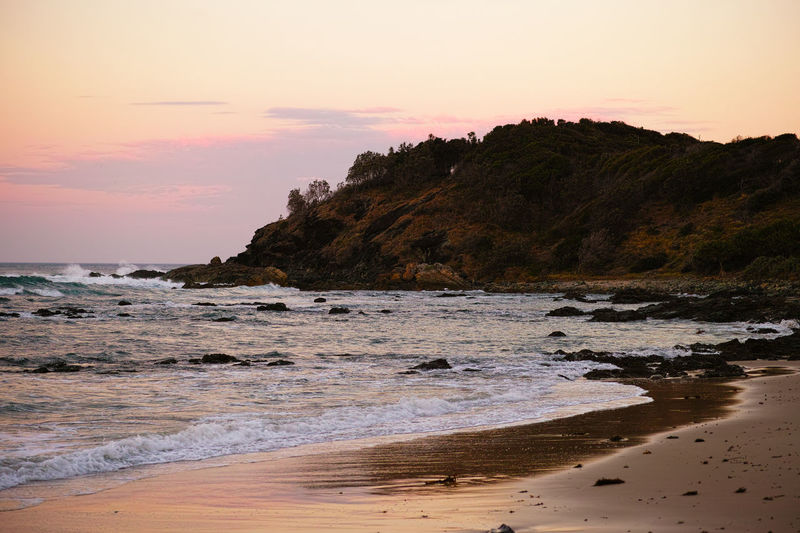Shelly Beach. Sunset Beach Sea Landscape Dramatic Sky Scenics Rock - Object Nature No People Tranquility Beauty In Nature Horizon Over Water Sky Outdoors Cliff Sand Tranquil Scene Water Travel Destinations Sun Pink Light Holiday Australia Port Macquarie