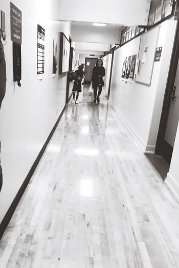 Long Hall Hallway Real People Lifestyles Men Indoors  Built Structure Walking Tiled Floor Full Length Illuminated The Way Forward Architecture Women Day Young Woman People Young Adult Adults Walking