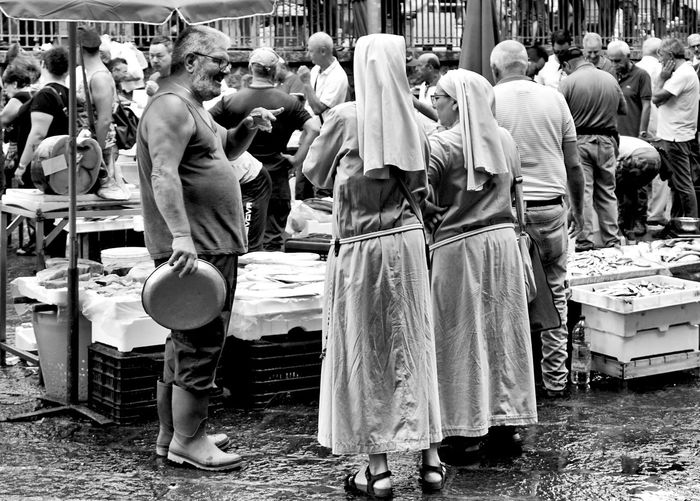 nuns on a fish market in Catania, Sicily, Italy Real People Crowd Market Women Market Stall City Rear View Standing Shopping Fish Market Catania Sicily Nuns