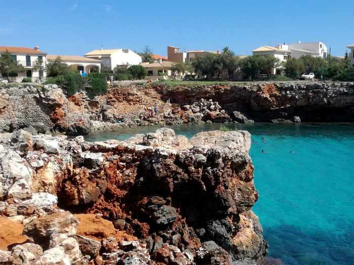 Turquoise Water Turquoise Sea Cap Beachphotography Calas Hermosas De Mallorca Bay Holiday Destination Mallorca (Spain) Clear Water Blue Water Blue Sky Beauty In Nature Water Tree Beach Sea Sunlight Sky Architecture Building Exterior Built Structure Shore