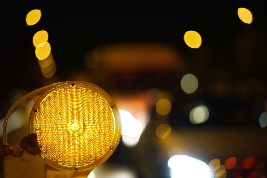 Illuminated Night Lighting Equipment Electricity  Glowing Light Light - Natural Phenomenon Focus On Foreground Electric Light No People Circle Lens Flare Close-up Geometric Shape Decoration Technology Shape Defocused Yellow Outdoors Nightlife Electric Lamp Traffic Lights