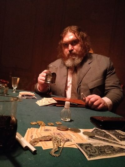 Portrait of man drinking glasses on table