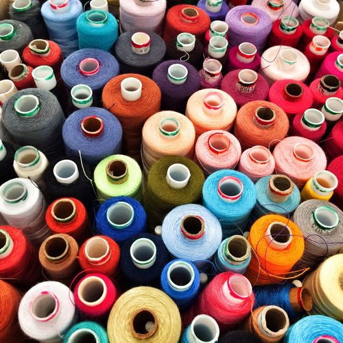 Reels of cotton sewing threads Multi Colored Craft Sewing Sewing Stuff Choice Variation Sewing Item Abundance Close-up Spray Paint Arrangement Full Frame Backgrounds Rolled Up Aerosol Can No People Indoors  Day