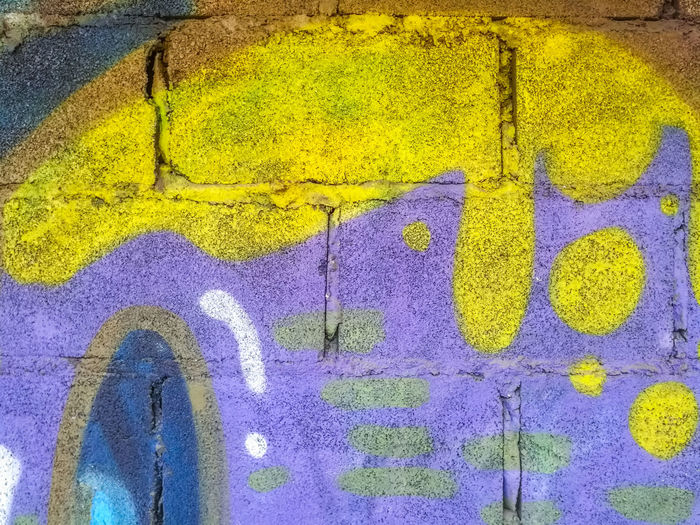 Abstract Activity Art Brick Wall Cement Wall Close-up Communication Day Decorate Design Drawings Graffiti Idea Modern No People Outdoors Painting Pattern Sign Story Street Style Symbol Textured  Yellow