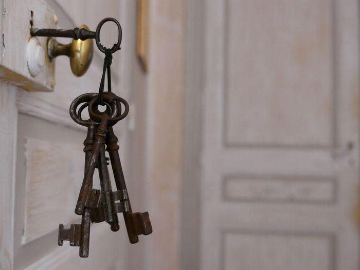 Close-Up Of Keys In Closed Door