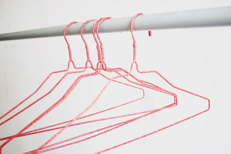 Hangers Wardrobe Shop Hanger Hangers Hang Red No People Close-up Indoors  Pattern White Background Still Life Textile Pink Color Decoration White Color Art And Craft Studio Shot