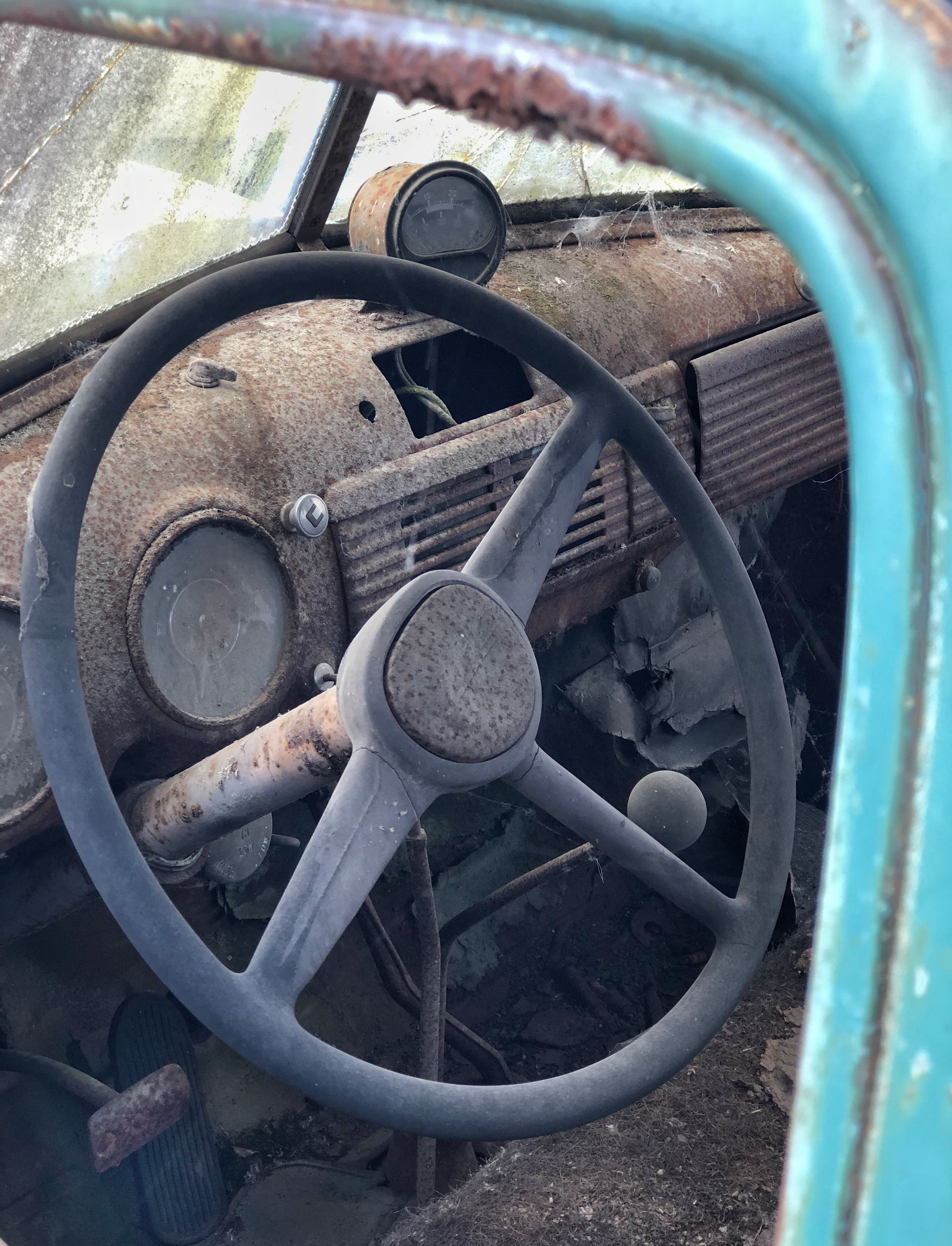 metal, no people, steering wheel, close-up, transportation, mode of transportation, rusty, wheel, abandoned, day, old, machinery, valve, shape, circle, land vehicle, obsolete, outdoors, geometric shape, machine part, deterioration, tire, iron - metal