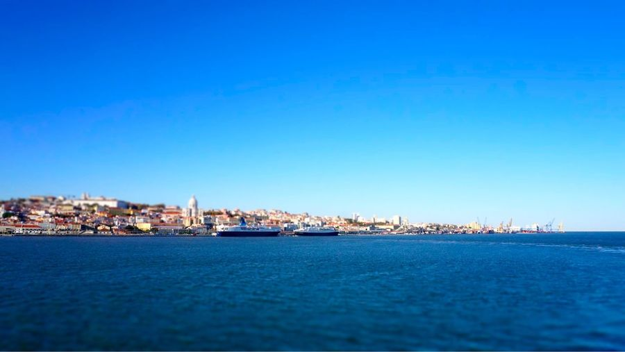 Lisbon Tiltshift Portugal Lisbon - Portugal Blue Water Sea City Cityscape Architecture Scenics Built Structure No People Outdoors Waterfront Transportation Nautical Vessel Building Exterior Clear Sky Day Sky Harbor