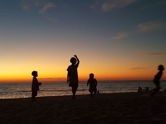 Kids Leader Orange Sky Shadows & Lights Sunlight Tranquility Amazing Awesome_shots Beach Beauty In Nature Black And Orange Fun Horizon Over Water Nature Outdoors Playing Sand Scenics Sea Shadow Shadows Sky Sunset Sunset #sun #clouds #skylovers #sky #nature #beautifulinnature #naturalbeauty #photography #landscape Water