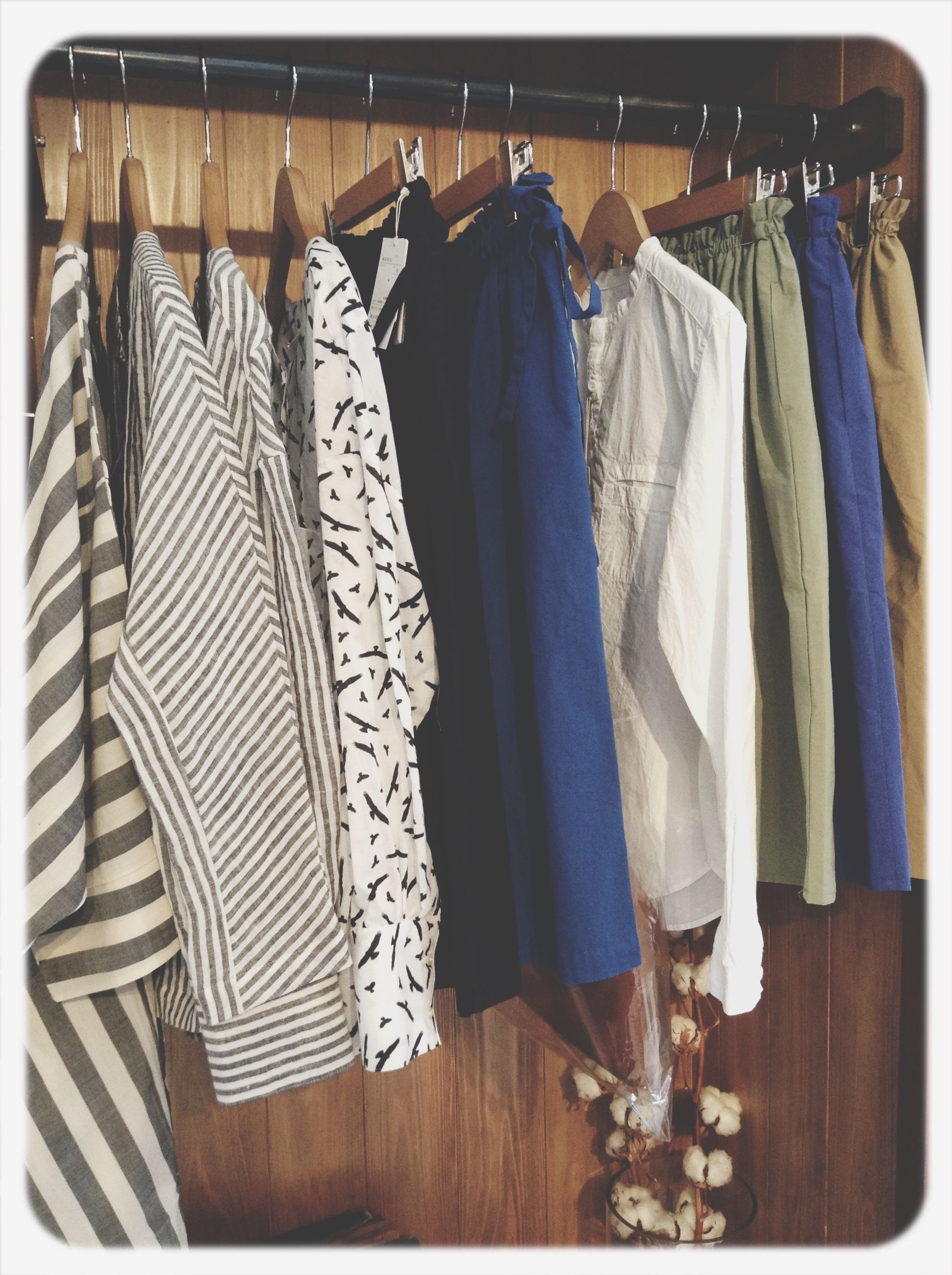 transfer print, auto post production filter, indoors, clothing, hanging, textile, in a row, side by side, standing, panoramic, fabric, men, rear view, curtain, day, laundry, drying, person, shopping