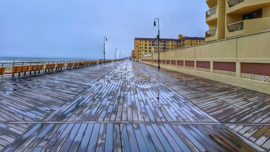 Boardwalk -- spent a little time in Long Beach with my New York fam. ❤ you can check out my hdr edit of this on my other account: @poetographer. Boardwalk Photography Boardwalk Architecture Building Buildings Building Exterior Built Structure Man Made Object Man Made Structure Sky Cloudy Cloud - Sky Clouds Overcast Rain Rainy Rainy Day Rainy Days Day Outdoors No People Urban Geometry Urban Ocean Landscape