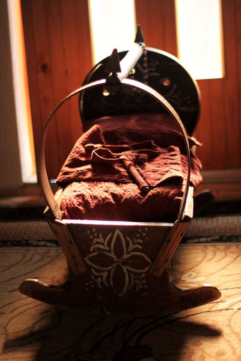 traditional wooden cradle in front of sunlight Albanian Children Aged Babies Baby Cradle Close-up Djep Food And Drink Home Interior Indoors  No People Old Table Traditional Wood - Material Wooden