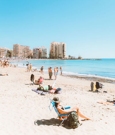 Beach Clear Sky Day Group Of People Horizon Over Water Land Large Group Of People Leisure Activity Lifestyles Men Nature Outdoors Real People Sand Sea Sky Trip Vacations Water Women