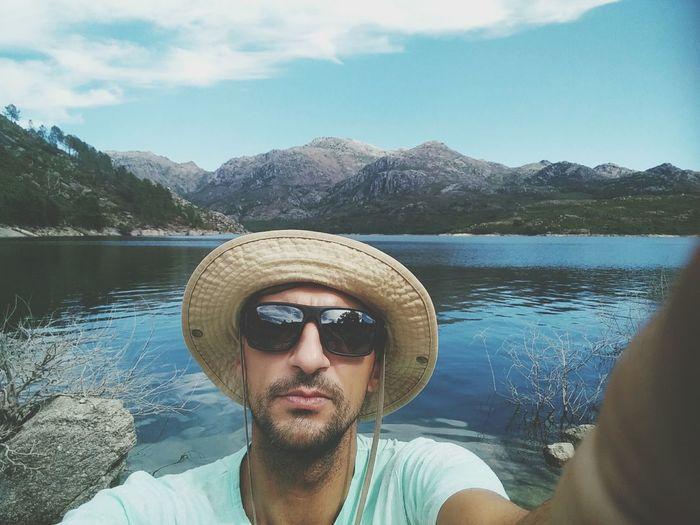 EyeEm Selects Headshot Sunglasses Lake Water One Man Only Mountain One Person Portrait Day Nature Exploration Outdoors Looking At Camera People Adventure Summer OnePlusOne📱 Oneplus One Shotononeplus Oneplusonephotography Portugal GêresPortugal VilarinhodasFurnas Reflection