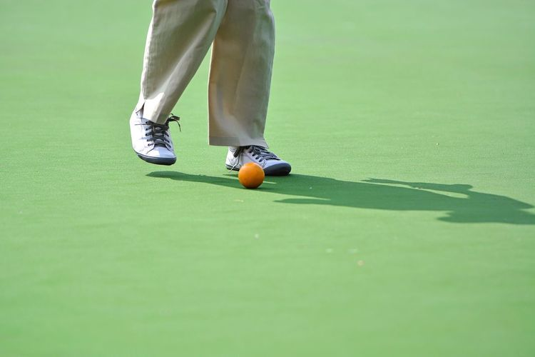 Man's leg and Lawn bowl on the green field Man Leg Lawn Lawn Bowls Bowl Bowling Healthy EyeEmBestPics People Outdoor Athlete Backgrounds Ball Green Field EyeEm Selects EyeEm Best Shots Eyeemphotography Business Golfer Golf Course Sportsman Golf Club Green - Golf Course Low Section Golf Competition Sport Competitive Sport Full Frame
