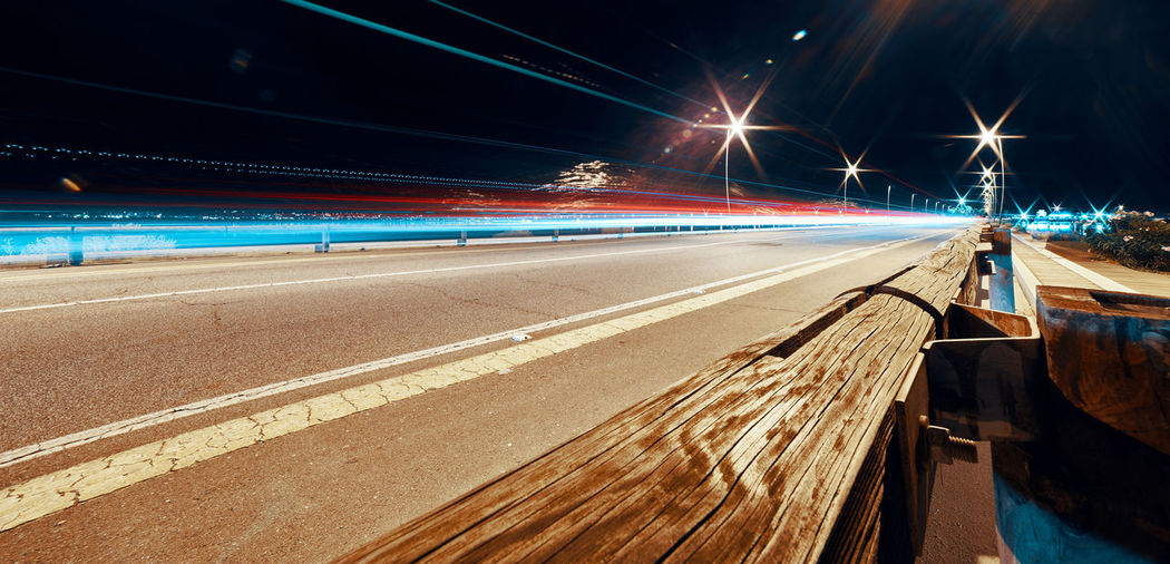 Long Exposure Shot Nightphotography Architecture Blurred Motion Built Structure Car Trails City Connection Illuminated Light Trail Long Exposure Motion Nature Night No People Road Sign Speed Street Street Light Symbol The Way Forward Transportation 17.62°