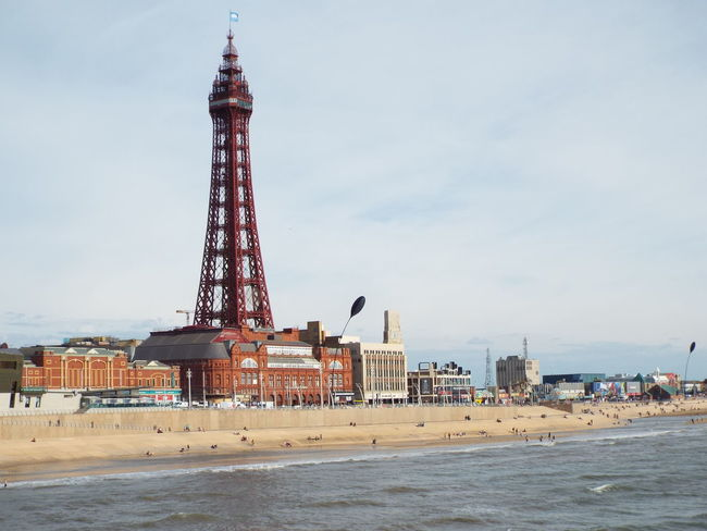 View of Blackpool Tower and the sea front from Blackpool's North PierBlackpool Tower Sea Front Sea Pier North Pier The Essence Of Summer Summertime Summer 2016 Tourist Attraction  Tourists Tourism Blackpool North Pier Blackpool Promenade People On The Beach Blackpool Beach Sand