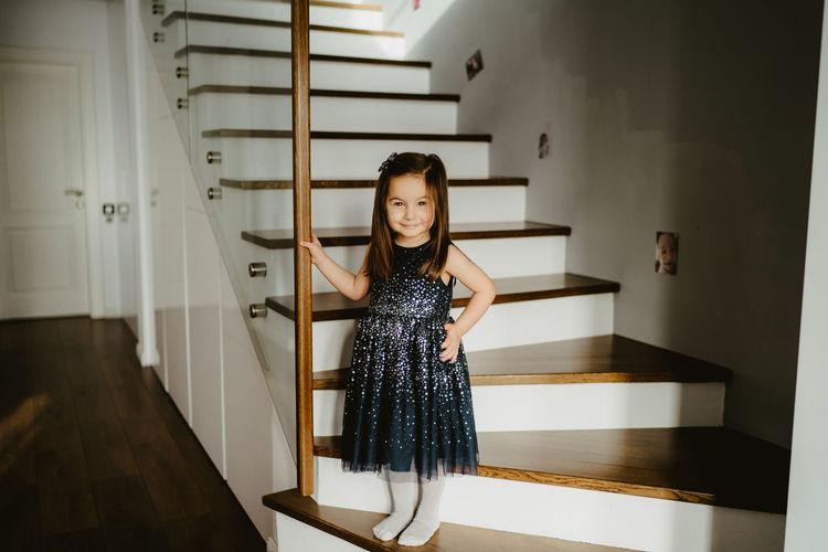 Full length of girl standing on floor at home