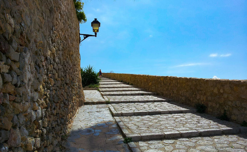 up Steps Up Vacation Ibiza Ibiza Town Castle It Goes Up Bluesky Wall Stone Material Sky Wall Lamp Hand Rail Stairs Stairway Worn Out Fort Stone Wall Staircase Steps And Staircases