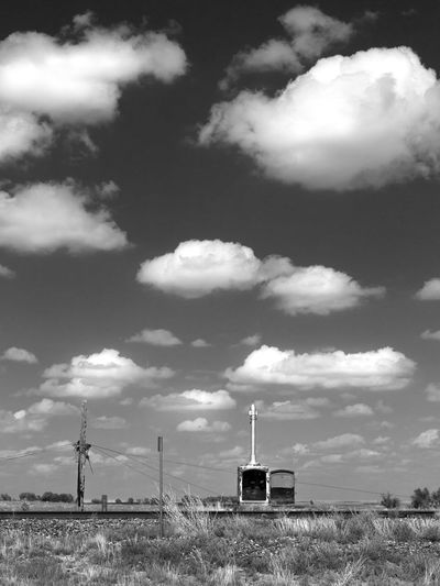 The Approach Atmosphere Atmospheric Mood Black And White Cloud Cloud - Sky Cloudy Desert Scrub Dramatic Sky High Plains No People Outdoors Prairie Railroad Railroad Track Sky Texture