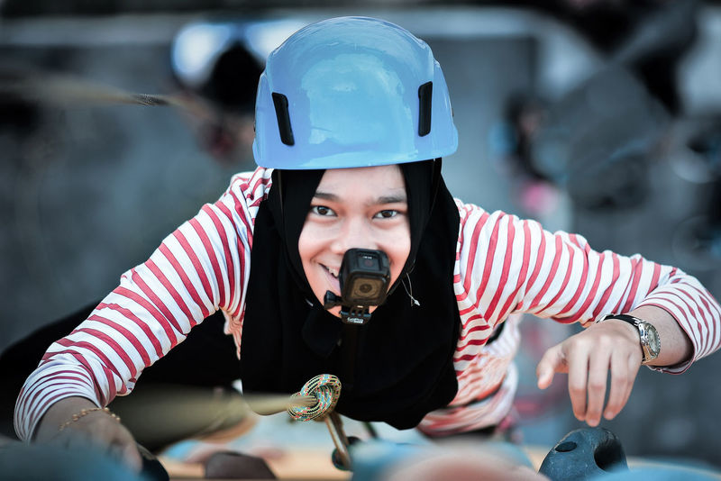 Adventure Time Climbing Girl Power Gopro Headwear Leisure Activity Leisure Games Leisure Time Looking Down One Person Outdoors People Sport Sports Helmet Taking Video Uniqueness Women Around The World Live For The Story Woman In Hijab
