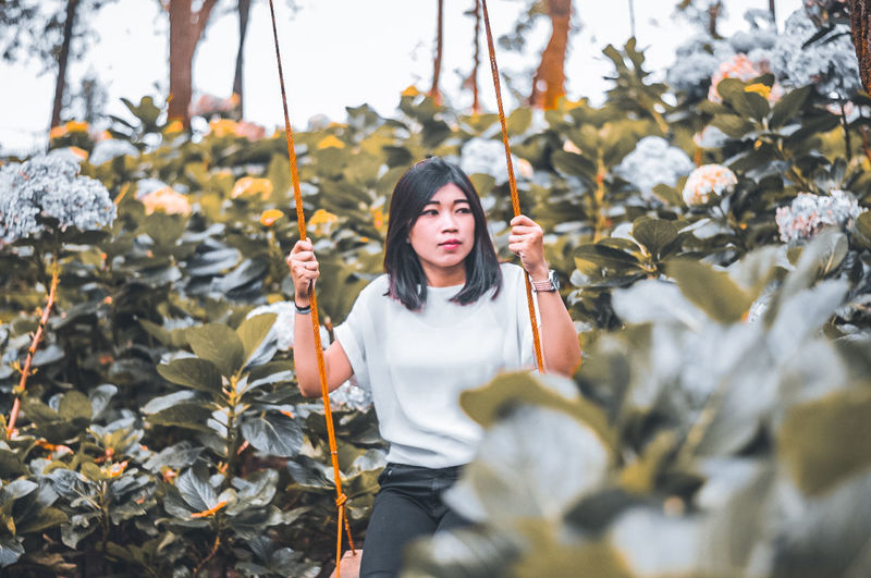 Young woman standing on leaves